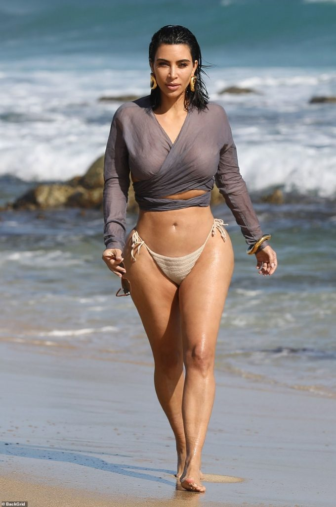 Kim Kardashian shows off her body in bikini bottoms