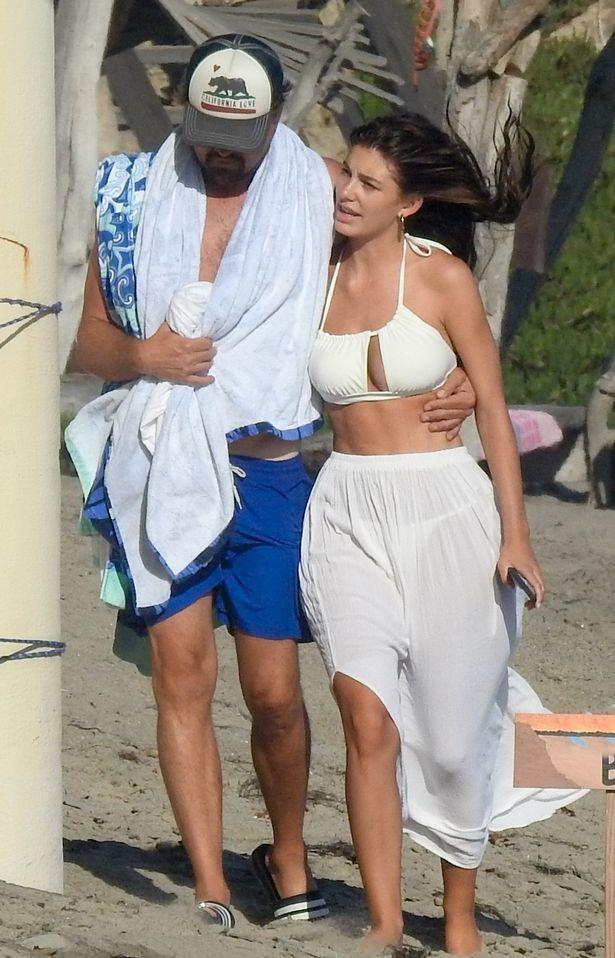 Leonardo DiCaprio, 45, and bikini-clad partner Camila, 23, delight in extremely frisky coastline day