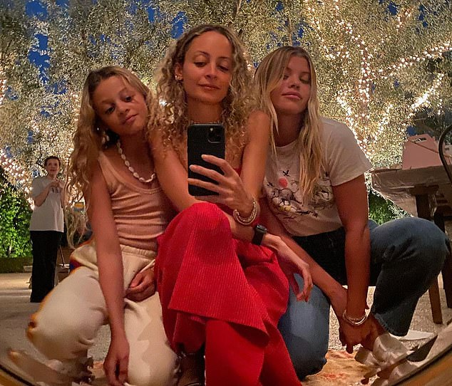 Sisters: She shared a sweet photo of herself with her older sister Nicole and her niece Harlow