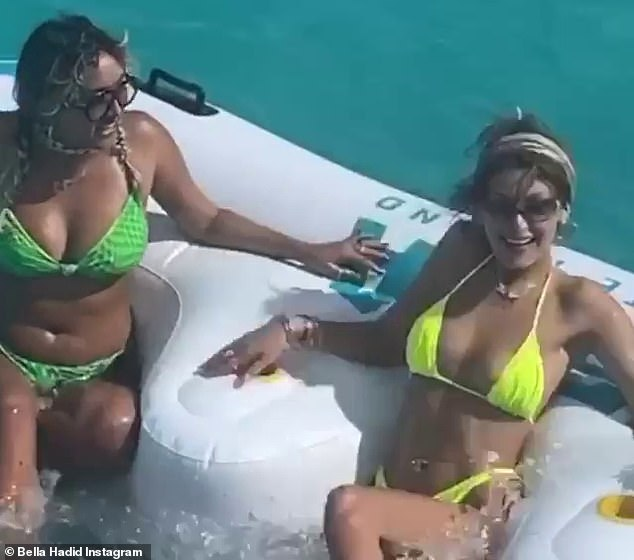 Serving body: The 24-year-old showed off her toned bod in the string bikini, as she jumped onto a massive float with her friend in the crystal clear ocean