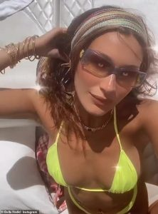 Bella Hadid radiates brilliant in hot yellow swimsuit while yacht with friends for 24th birthday celebration